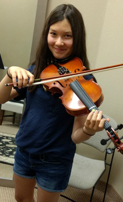 Girl Playing a Song On a Violin