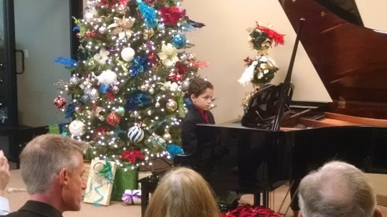 boy performing on piano