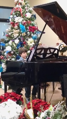 boy performing at piano